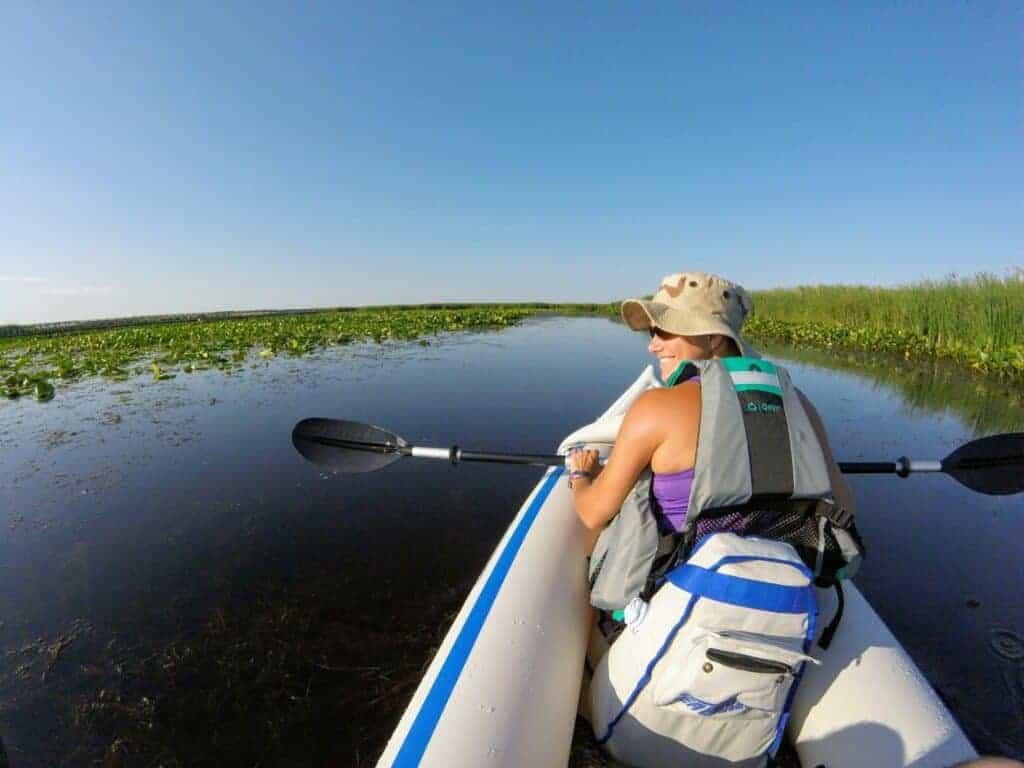 Woman kayaking in marsh