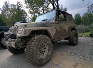 Mud-covered Jeep Wrangler