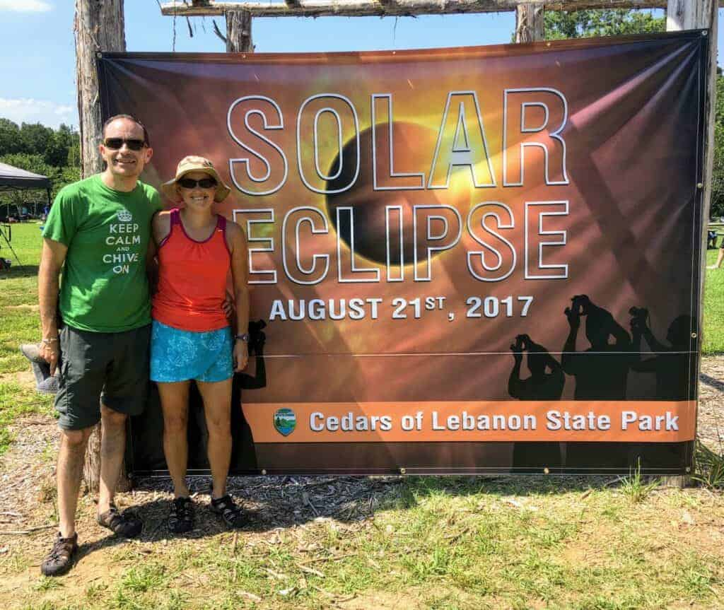 Man and woman with Solar Eclipse sign