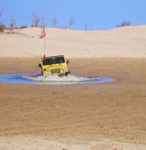 Jeep Wrangler in water hole