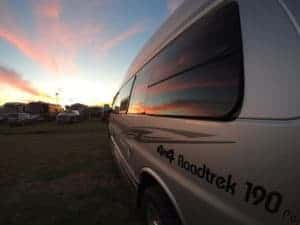 sunset shining on Class B RV to symbolize dream of nomad life