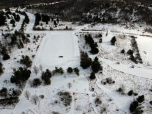aerial of parking lot at Sleepy Hollow State Park in winter