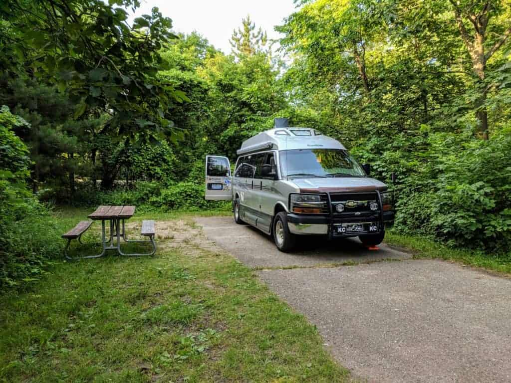 Class B RV in summer campsite at Sleepy Hollow State Park