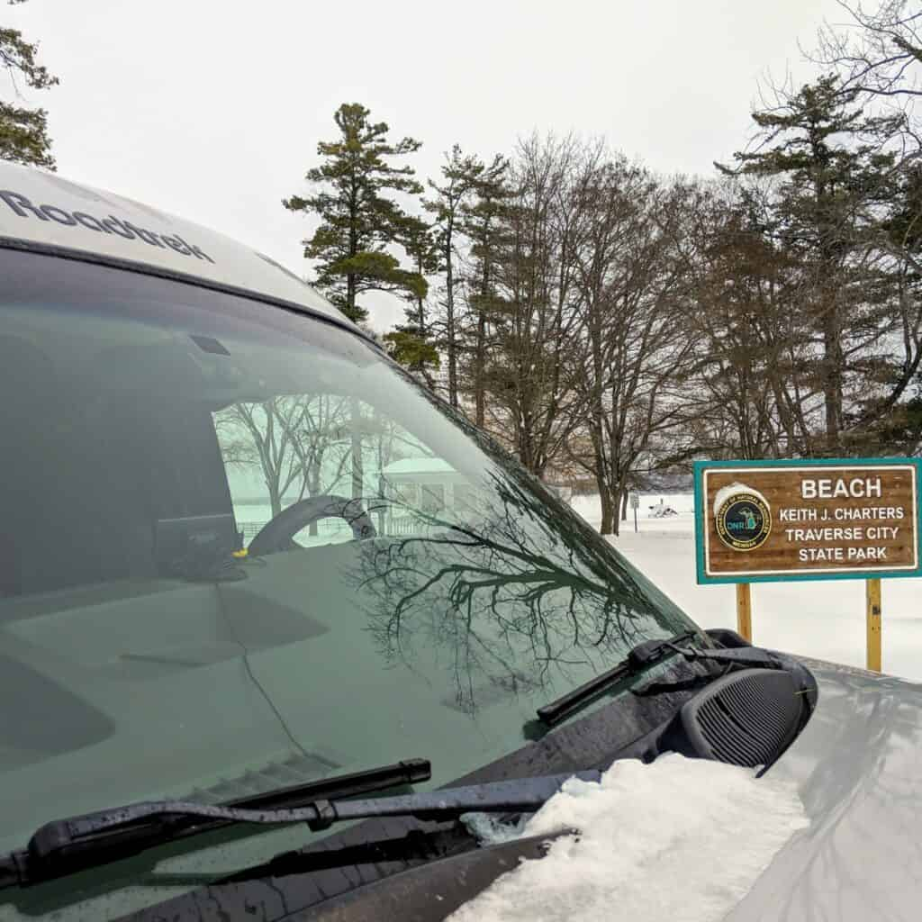 van and entrance sign at Traverse City State Park beach
