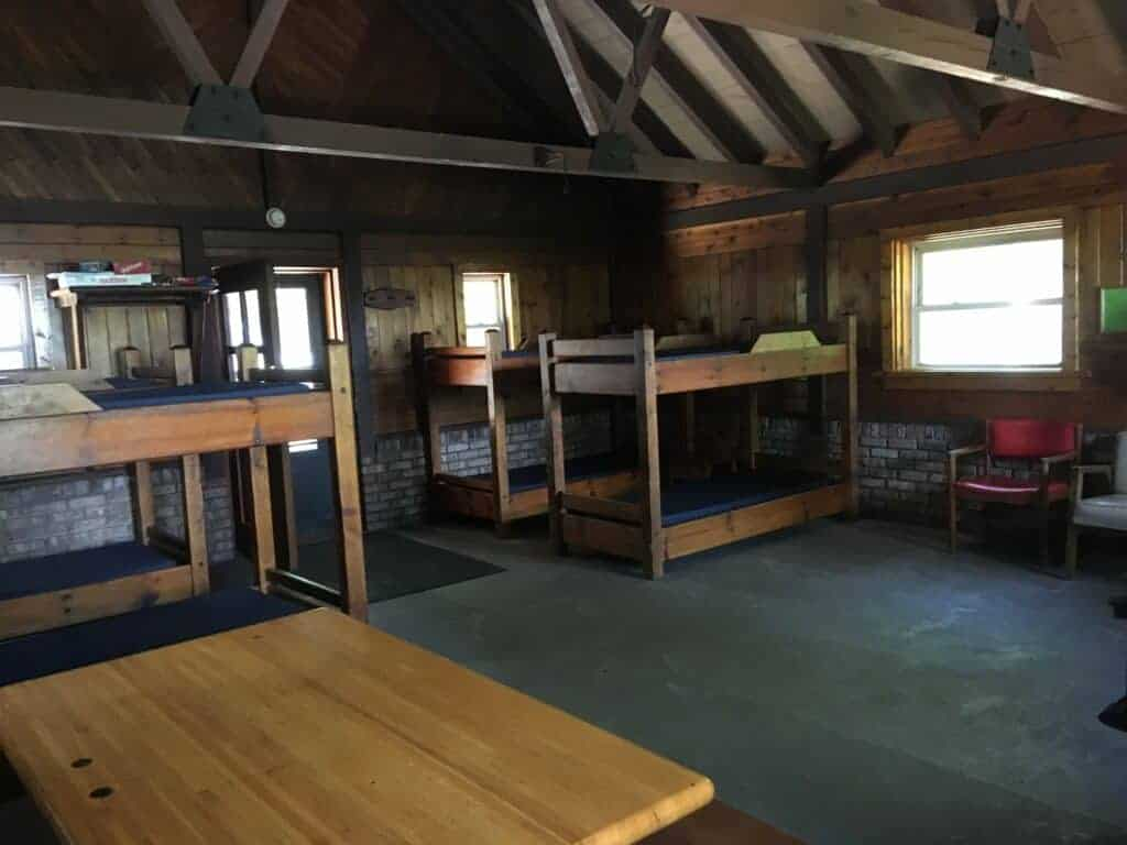 Inside of the mini cabin showing bunkbeds and dining table