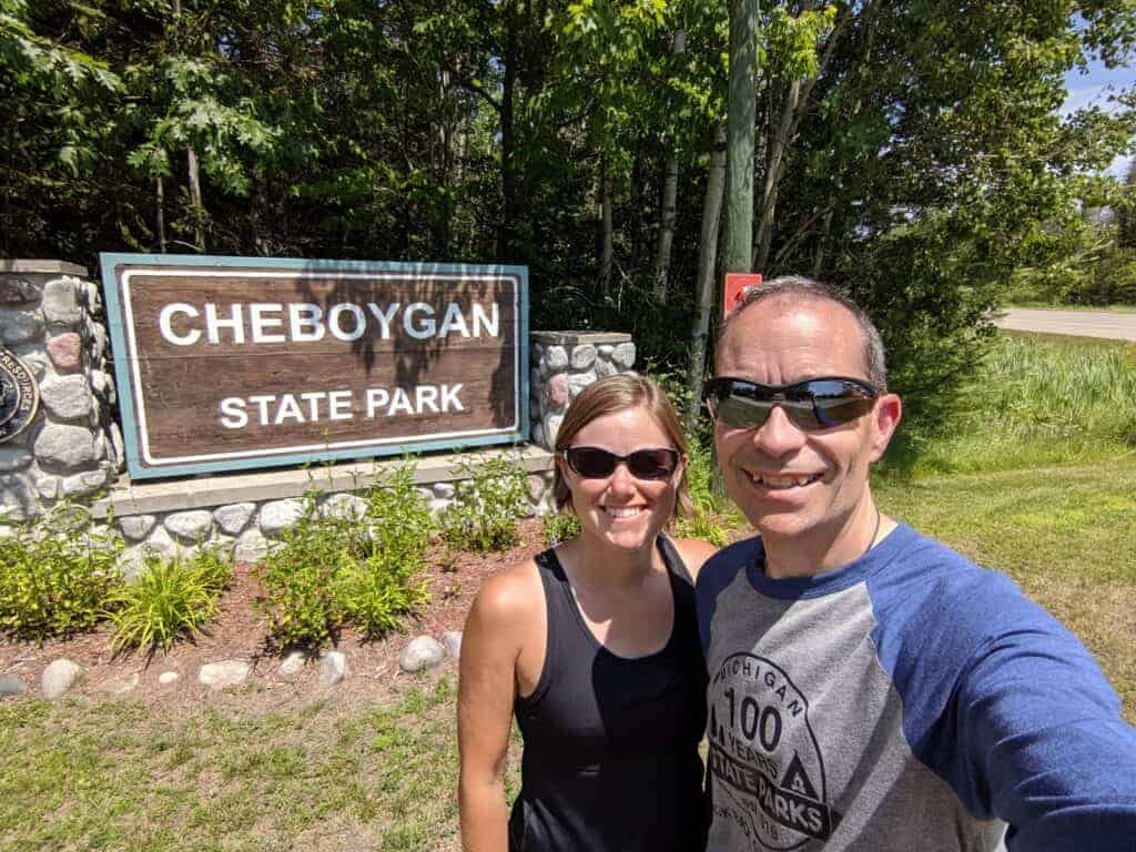 Ari and Jessi in front of the Cheboygan State Park sign