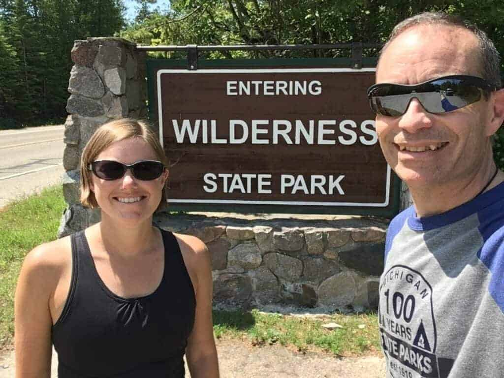Ari and Jessi in front of the Wilderness State Park sign