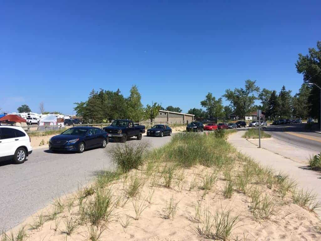 Vehicles lined up to enter Grand Haven State Park
