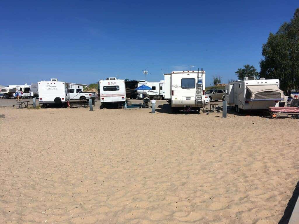 Trailers parked along the beach at Grand Haven State Park
