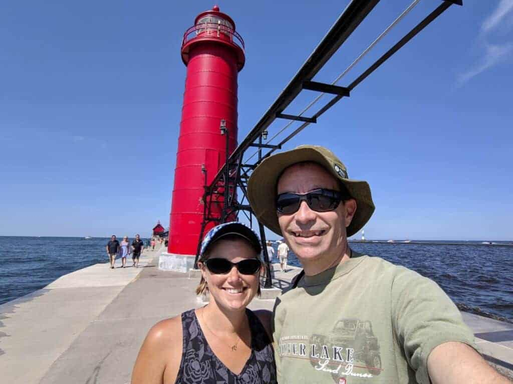 Two people on the pier at Grand Haven State Park