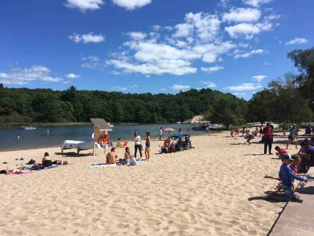 People on a beach at Hamlin Lake
