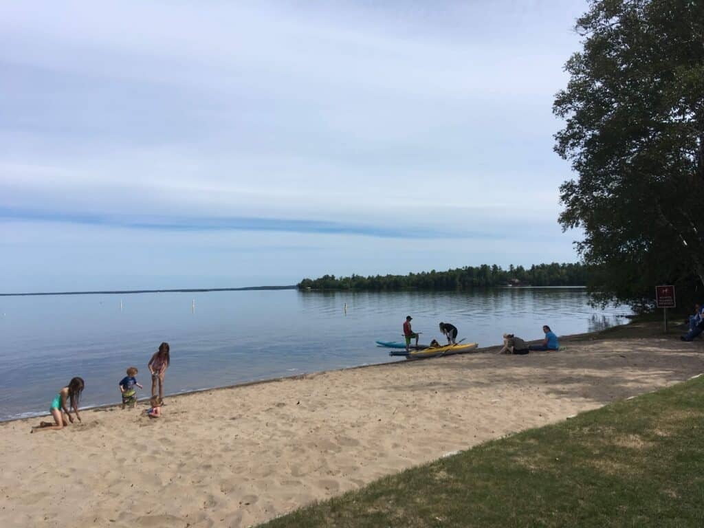 Kids playing on the beach at Indian Lake State Park