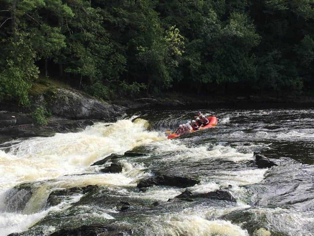 Group of whitewater rafters in the rapids