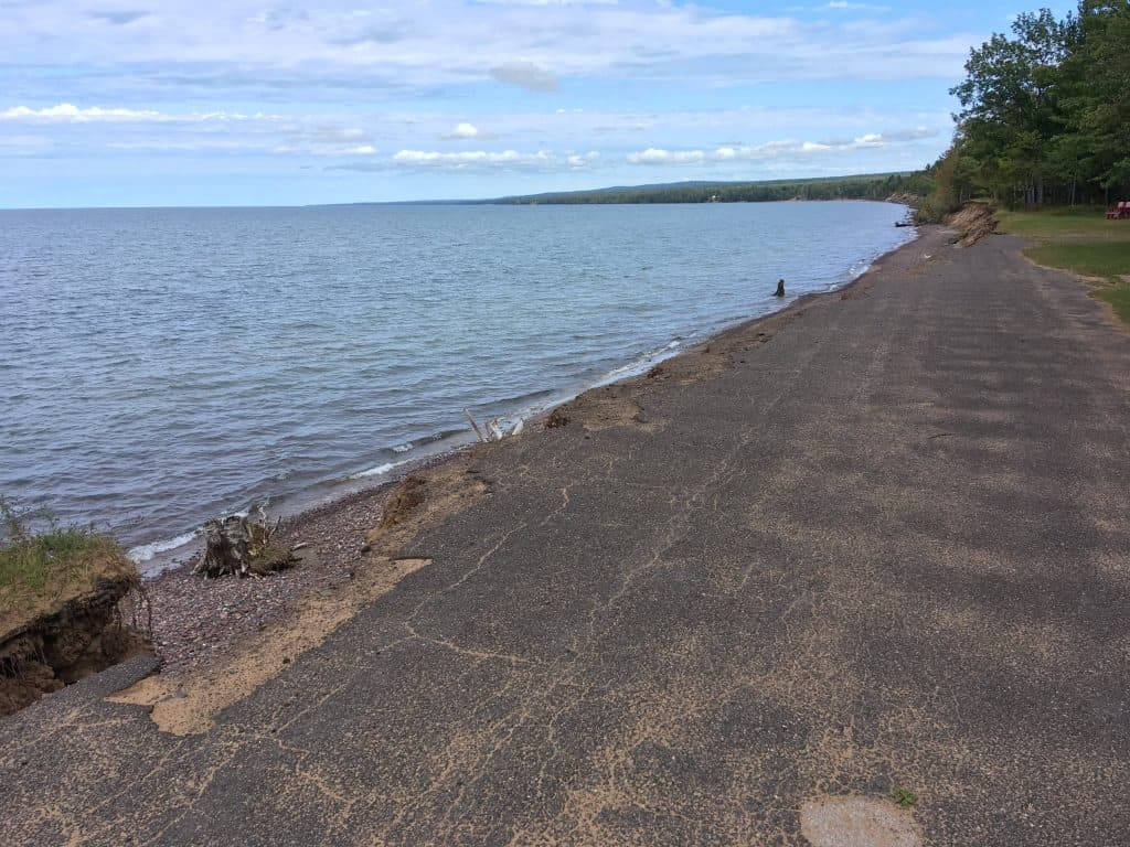 Crumbling road in front of Lake Superior at McLain State Park