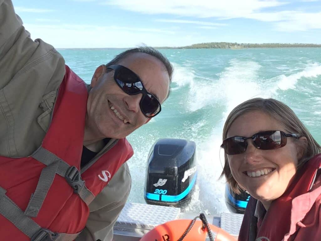 Two adults on a boat heading to Lime Island