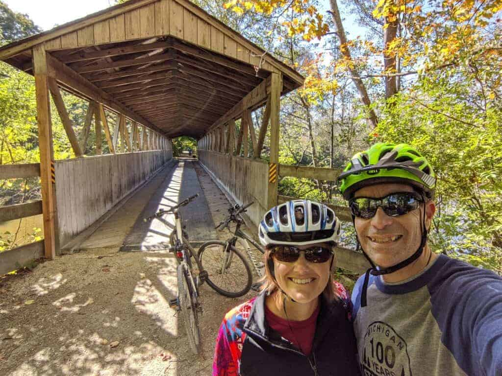 A man and woman wearing bike helmets on the Kal-Haven Trail State Park