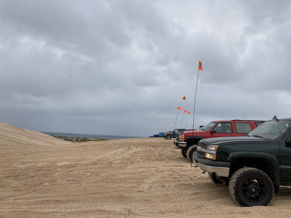 A row of ORVs on the sand dunes