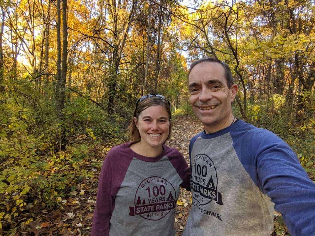 Two adults in the woods